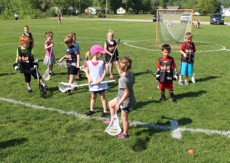 Coed Toddlers Playing Lacrosse